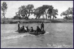 Men crossing the Duchesne River in on a raft.