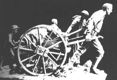 Man pulling handcart.